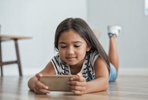Little girl on an iPhone