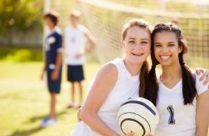 Girls Smiling playing Soccer